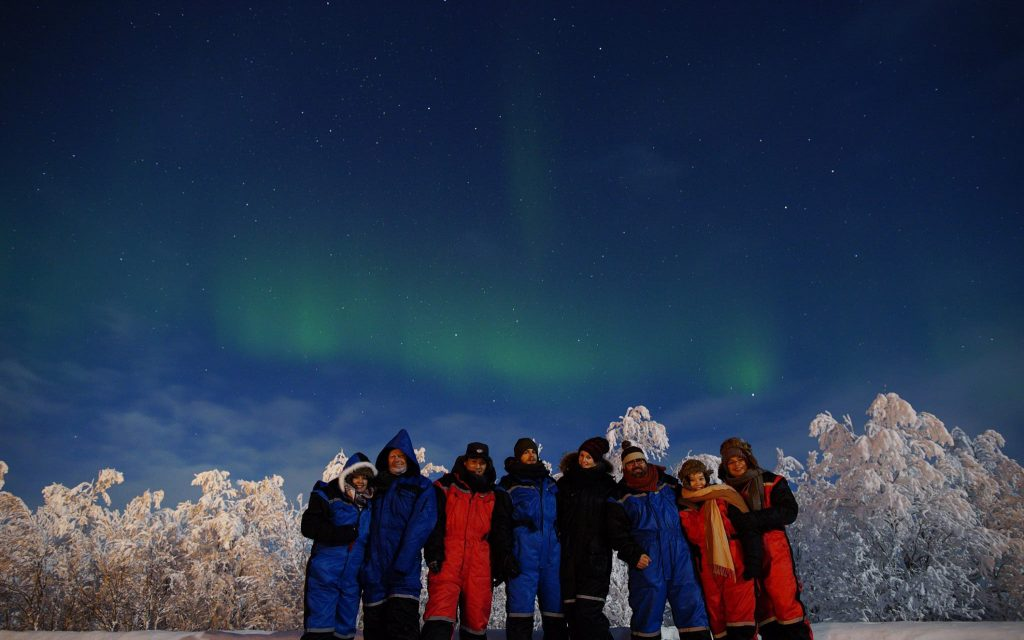 Groepsfoto onder het Noorderlicht